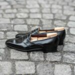 The Darcy penny loafer in black leather calf